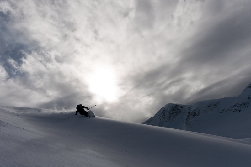 Juls, shredding early season pow above the Asulkan Hut in Roger's Pass. Photo: Phil Tomlinson