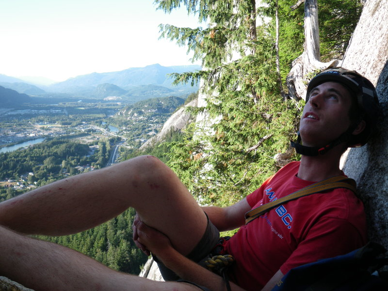 Ben Singleton-Polster chilling just below the bolt ladder on Europa, Stawamus Chief. Photo: Craig Alfredson