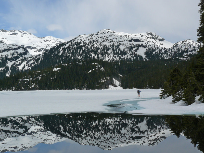 Christian Veenstra skiing across Callaghan lake on a VOC spring traverse over Callaghan and Ring. Photo: Gili Rosenberg