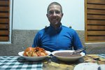 Eating langosta (lobster) for the first time, in Puerto Esperanza, a nice fishing village