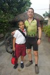 All the kids in Cuba dress in the same uniform for school, the color of the tie changes according to the grade. This kid lived i