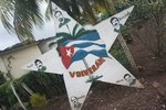 """""""They will return"""" (volveran). Many houses had signs about these five Cuban spies serving time in US prisons"""