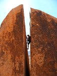 Dominique works his way up a scary and aesthetic chimney boulder in Red Rocks. Photo: Moos van Caspel