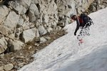 Boot skiing down another gully