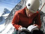 Nick Elson checking the guidebook, on Mctech Arete in the Bugaboos