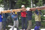 Moving a log for the new bridge by the hut