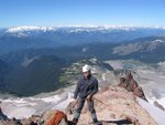 Piotr belaying Stu up to the summit ridge.