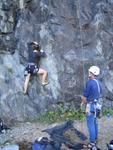 Elise climbing, Nick belaying
