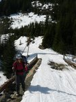 Carrying skis up Roe Creek FSR (we should have put them on)