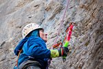 Christian Veenstra considers his next move while mixed climbing at Marble Canyon. Photo by Lee Wasilenko