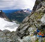 Geoff Martin belaying people up while on Fisher's Chimney on Mt. Shuksan. Photo: Nick Matwyuk