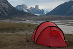 Mount Asgard rises behind one of our camps on a 9 day traverse of Auyuittuq National Park on Baffin Island. Photo: Scott Webster