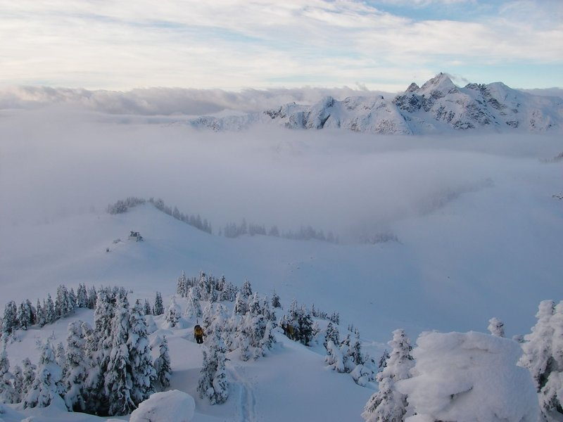 Cypress and the Brew hut emerge from a sea of clouds on Mt Brew. Photo: Christian Veenstra