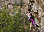 """Kasper Podgorski, dressed as a climber from a past decade, climbs on """"The Wave"""" in Skaha, BC. Photo: Ryan Goldsbury"""