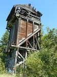 An old water tower (for trains) and Maya is picking Saskatoons