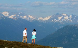 Roland shares some stories with Sarah C. while looking out towards the peaks of Garibaldi from Brew