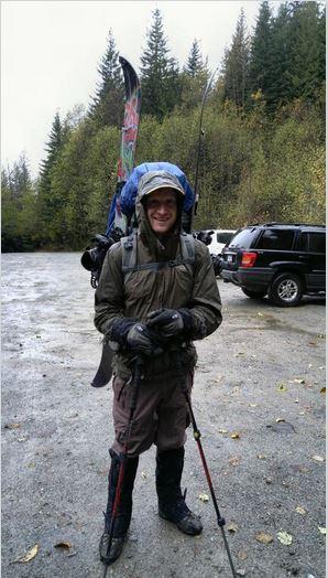 At the trailhead - Optimistic smile despite the rain. Photo F. Elder