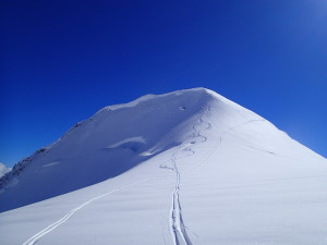 Nick Gobin dropping a cornice off of Tent Peak. Snow conditions were good here.