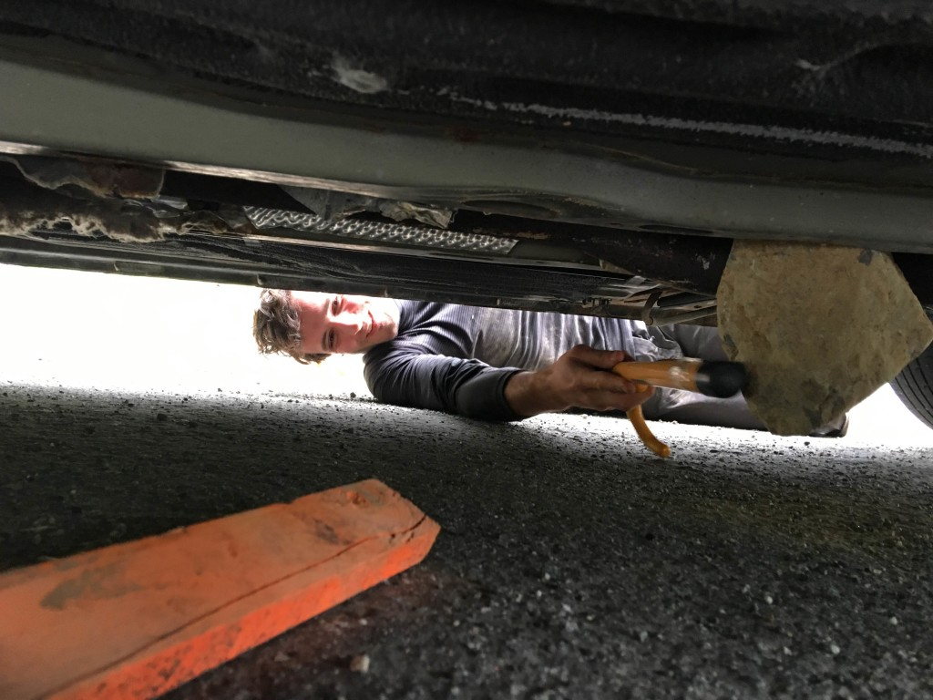 Luca inspecting the rock underneath his car.