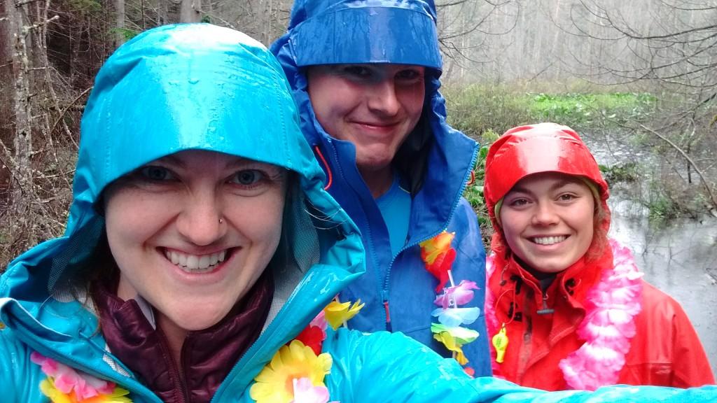 Cora, Jake and Roseanna hiking in the rain.