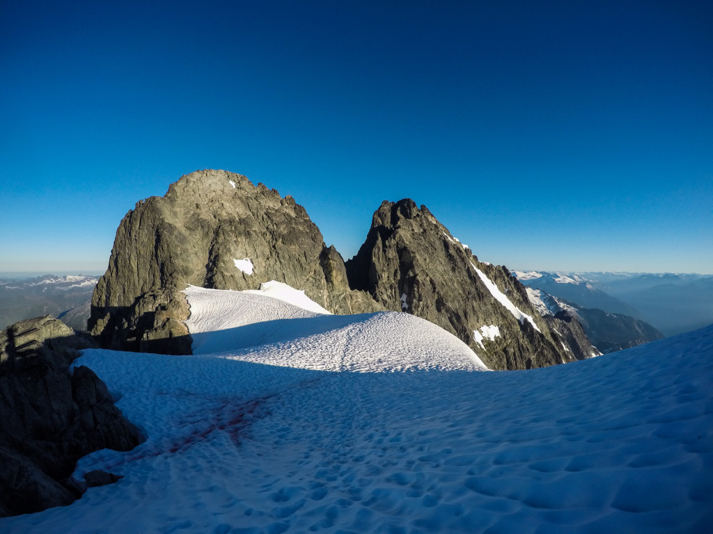 The high snow shoulder below Dione. My line of ascent started just right of the small snow patch. I climbed up and to the left, reaching the top of the snow patch, where I climbed straight up leading to easy terrain. Photo: Matteo Agnoloni