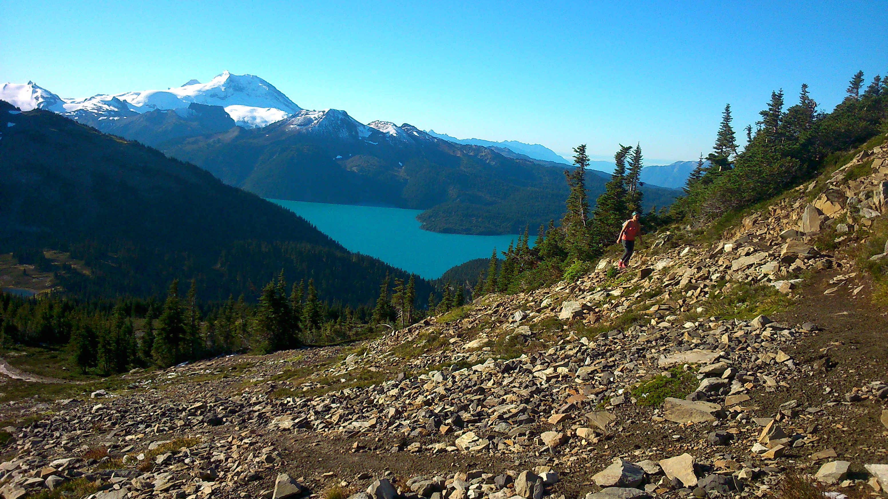 Geneviève running up towards Black Tusk, with Garibaldi Lake behind. Photo E. Skierszkan.