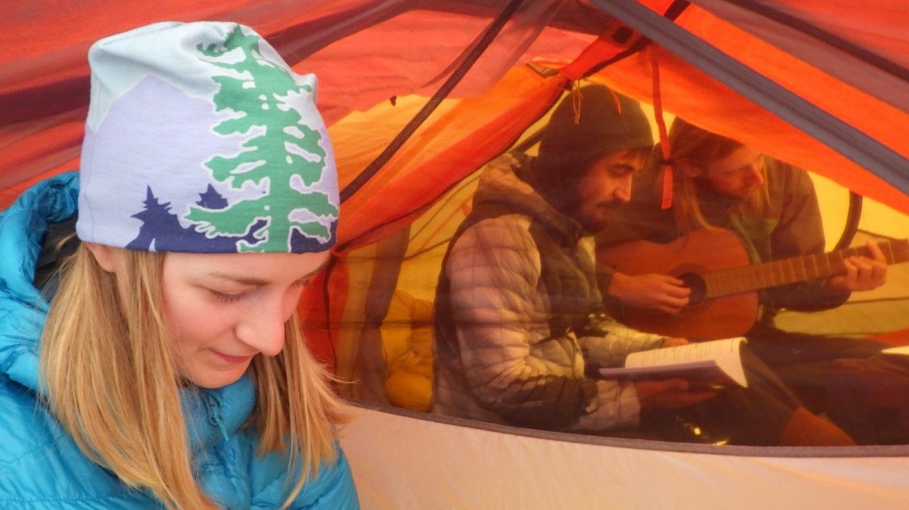 Playing guitar and singing in the tents. Photo by: Cora Skaien.