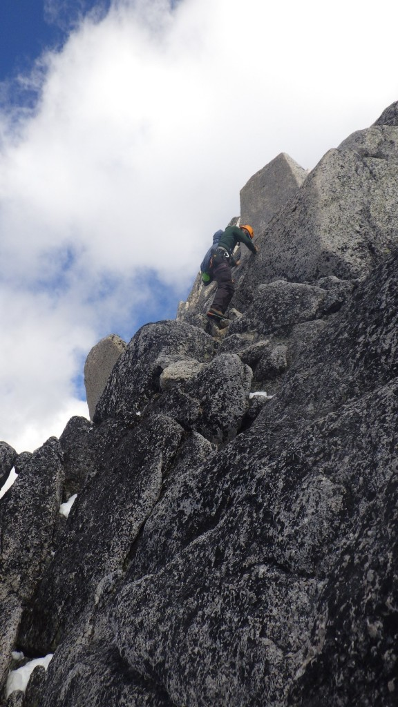 Artem down-climbing on the West Ridge. Photo by: Cora Skaien.