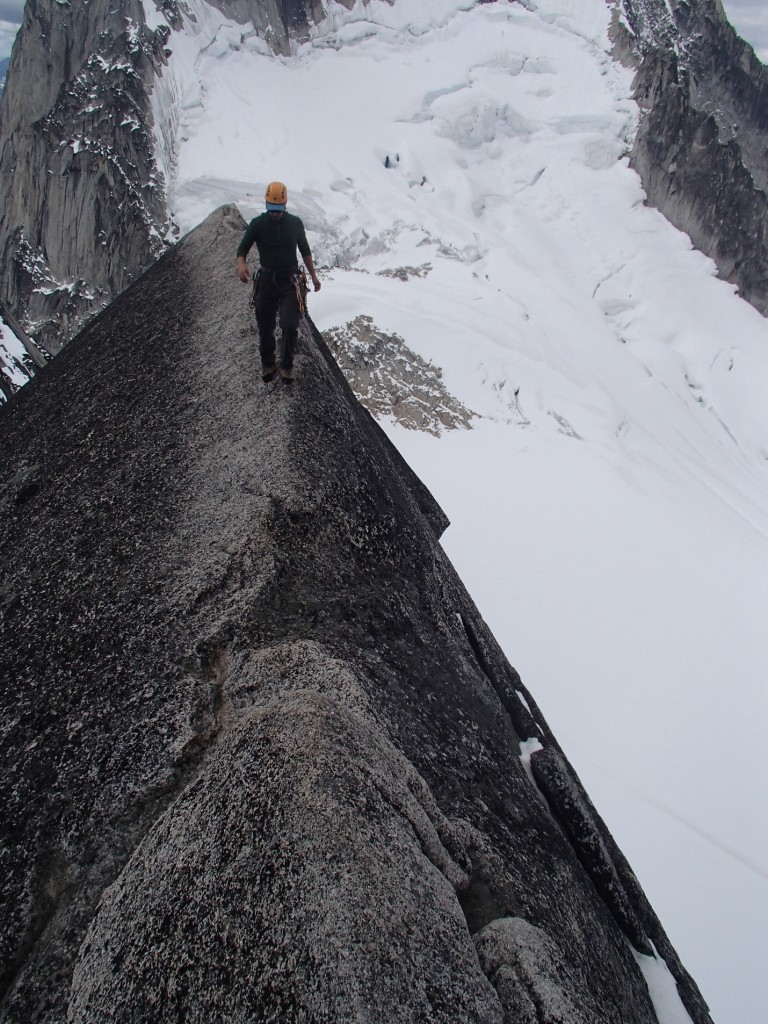 Artem walking across the classic ridge on the West Ridge of Pigeon Spire. Photo by: Jeff Taylor.