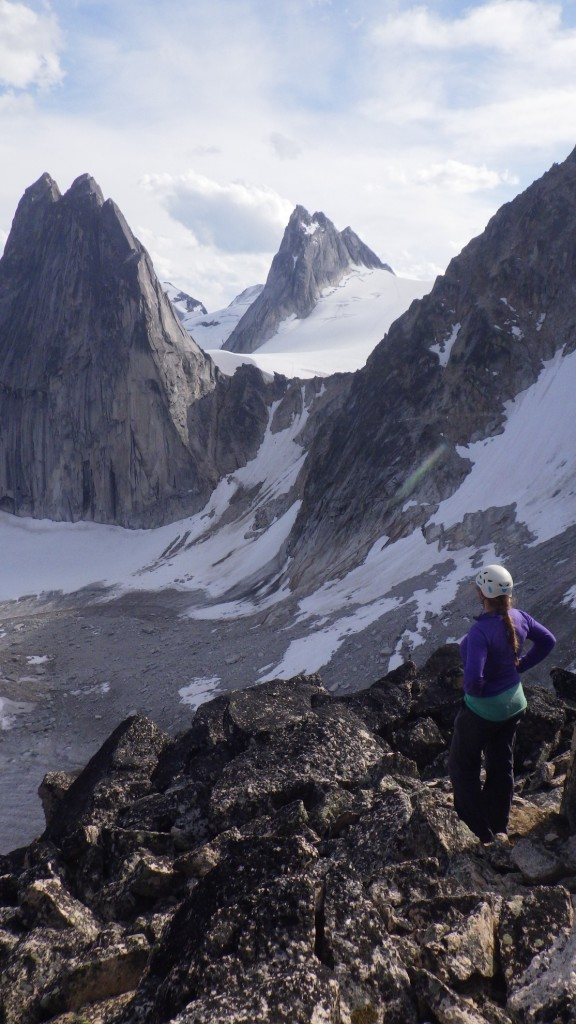 Cora enjoying the first views of Pigeon Spire (middle) with Snowpatch Spire on the left. Photo by: Carly Peterson.