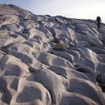 Spencer navigates glacial fluting on granite above Princess Louisa Inlet (Photo: S. Higgs)