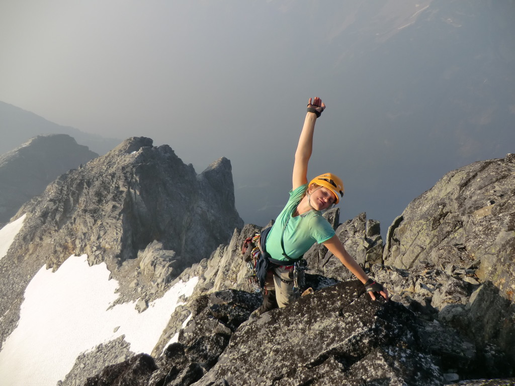 Caitlin enjoying the summit. Photo by Julien Renard