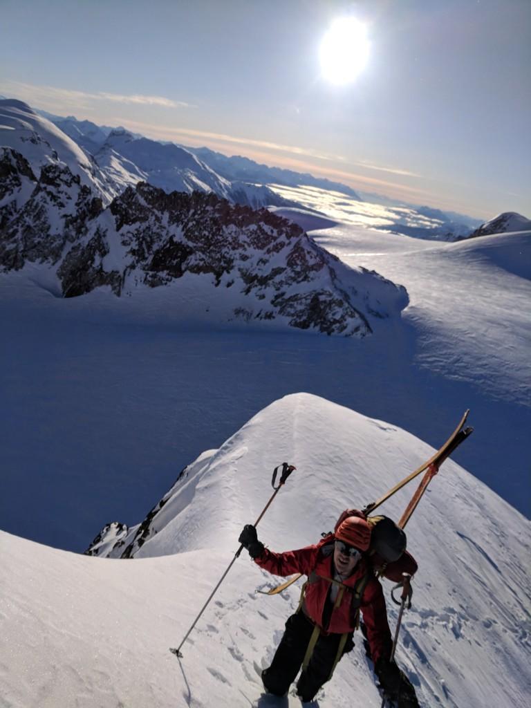 Nick bootpacks up the ridge to gain the summit of Eureka Mountain.
