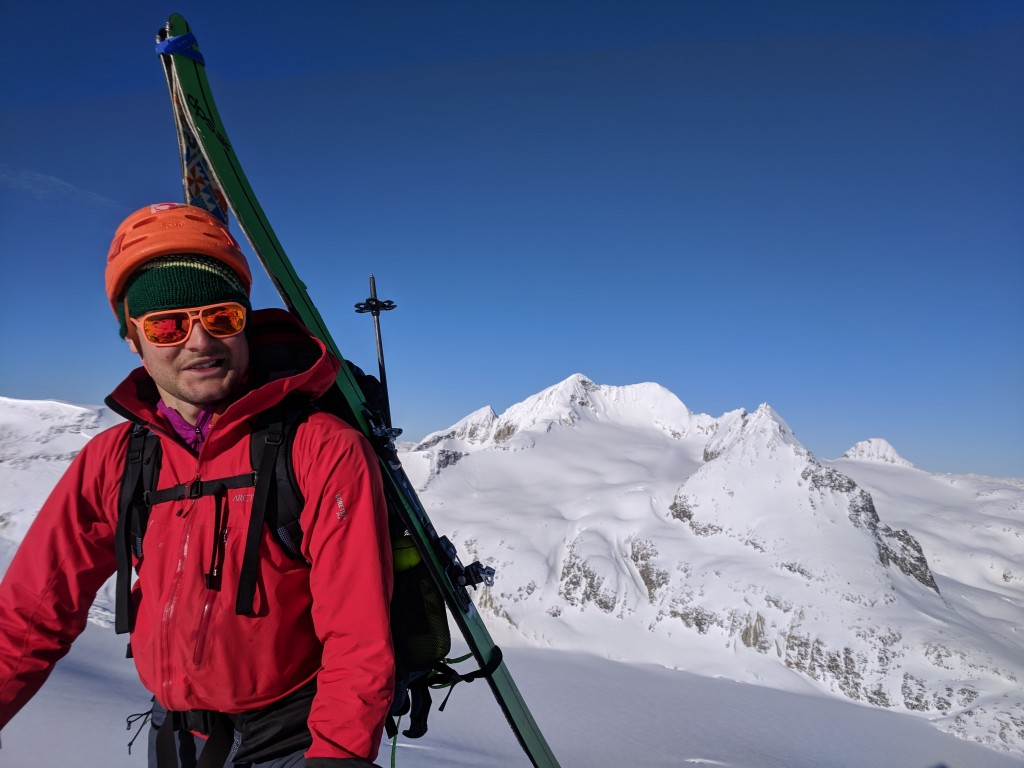 Olek on the summit of Eureka with Mount Weart in the background.