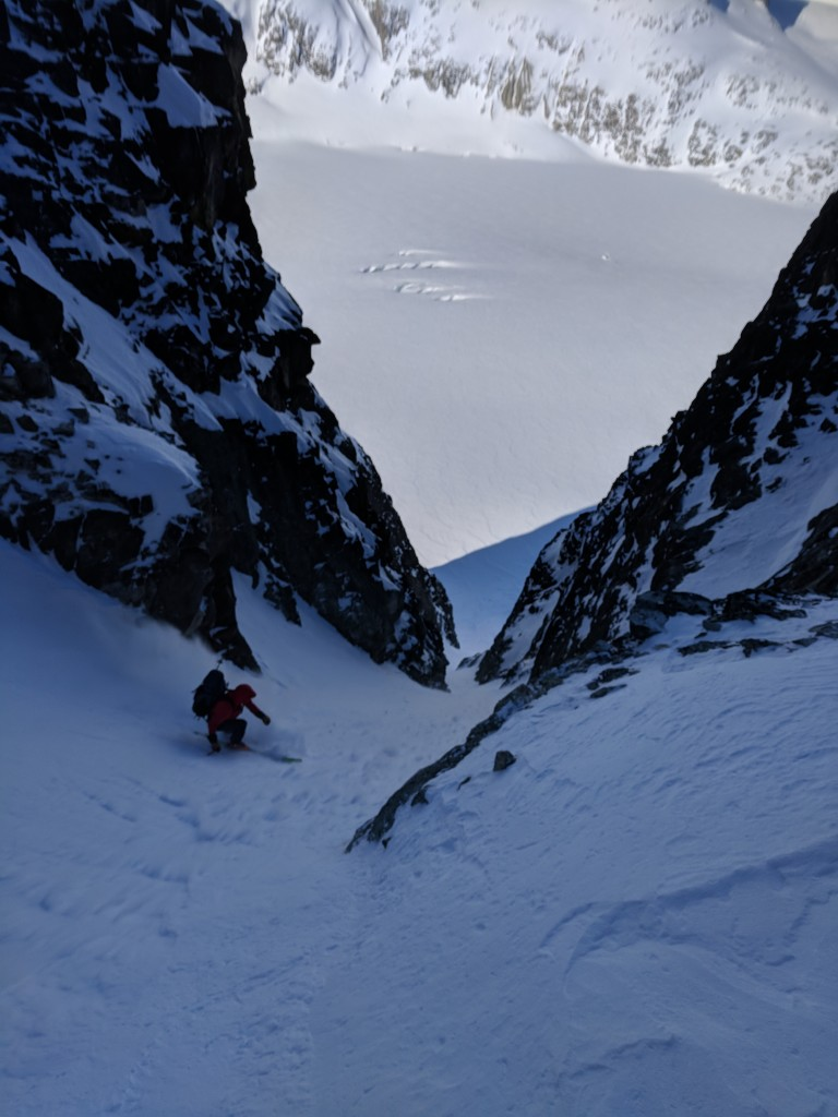 Olek skiing down the Eureka NW couloir with the Weart Glacier in the background.