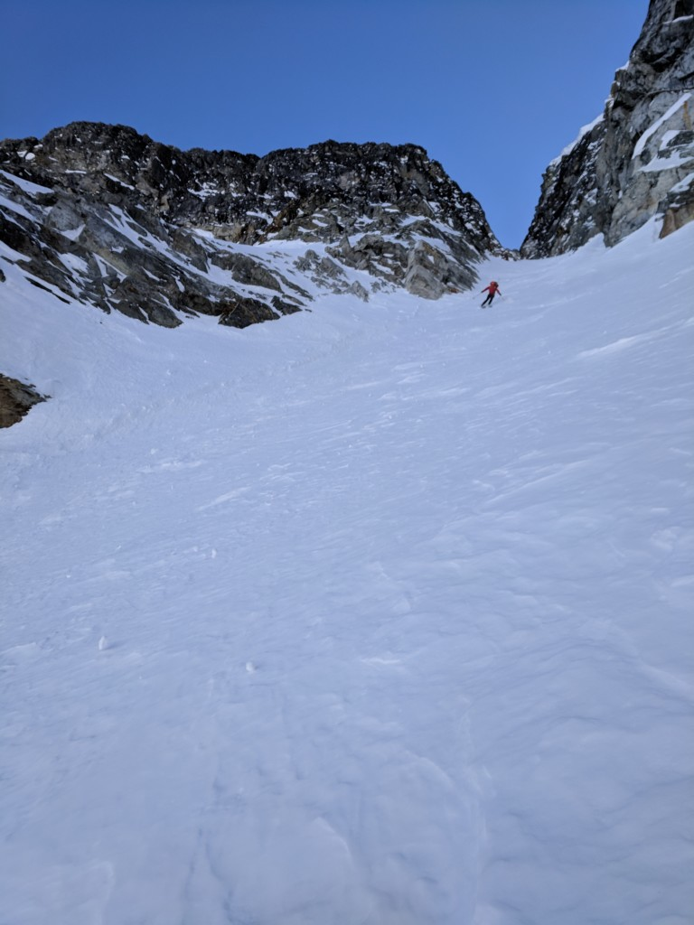 Nick opening up his turns as the couloir widens.
