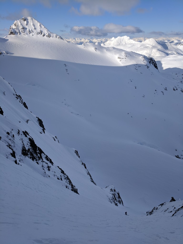 Olek nears the bottom of the couloir with Mount Moe in the background.