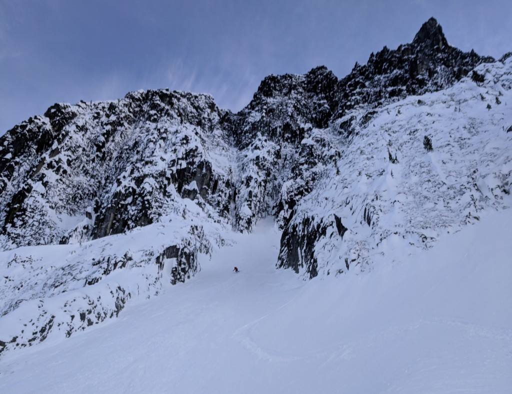 Olek exiting the final couloir of the trip. The Mordor-like, jagged sub-summits of Currie in the background.