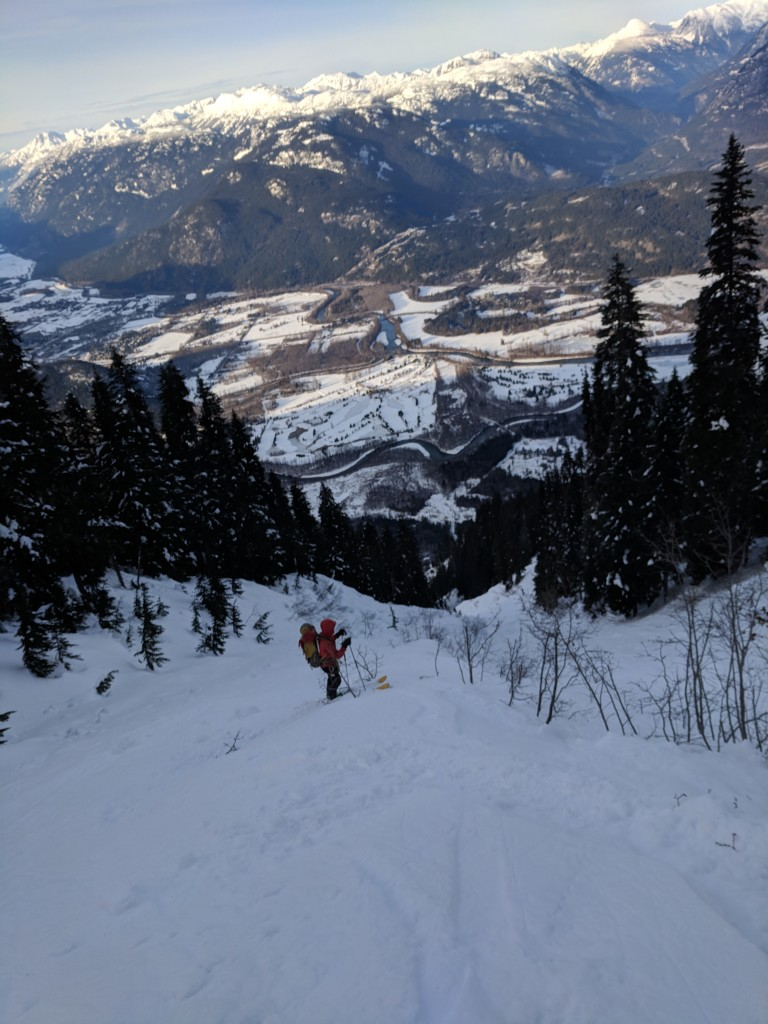 Nick following old ski tracks. Less snow, more trees. Still a ways from the truck.
