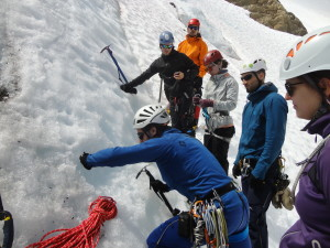 Building ice anchors (photo by Christine Beaulieu)