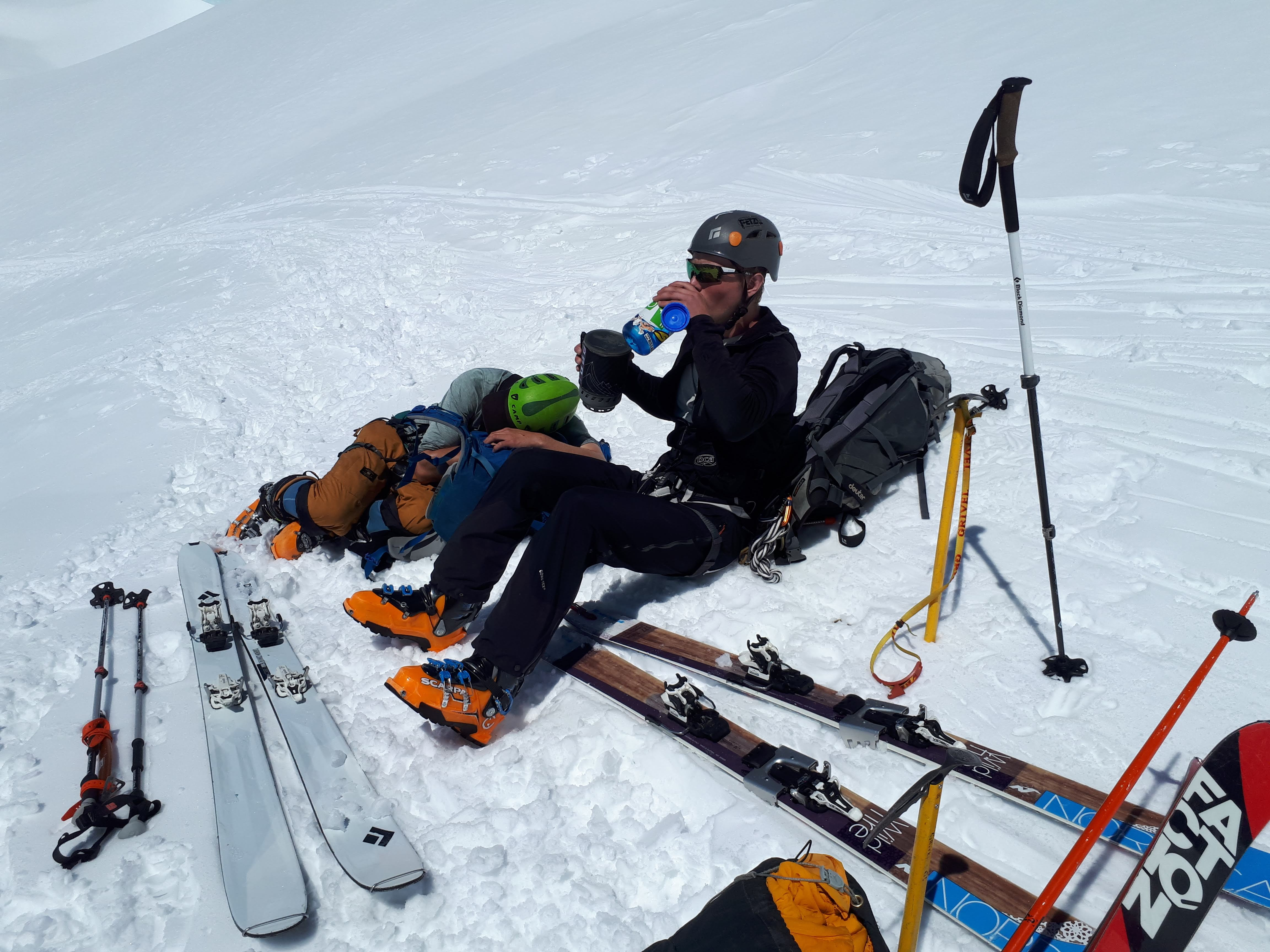 Justin rehydrates while Duncan power naps at 4000m. Photo cred: Tobias Huxol
