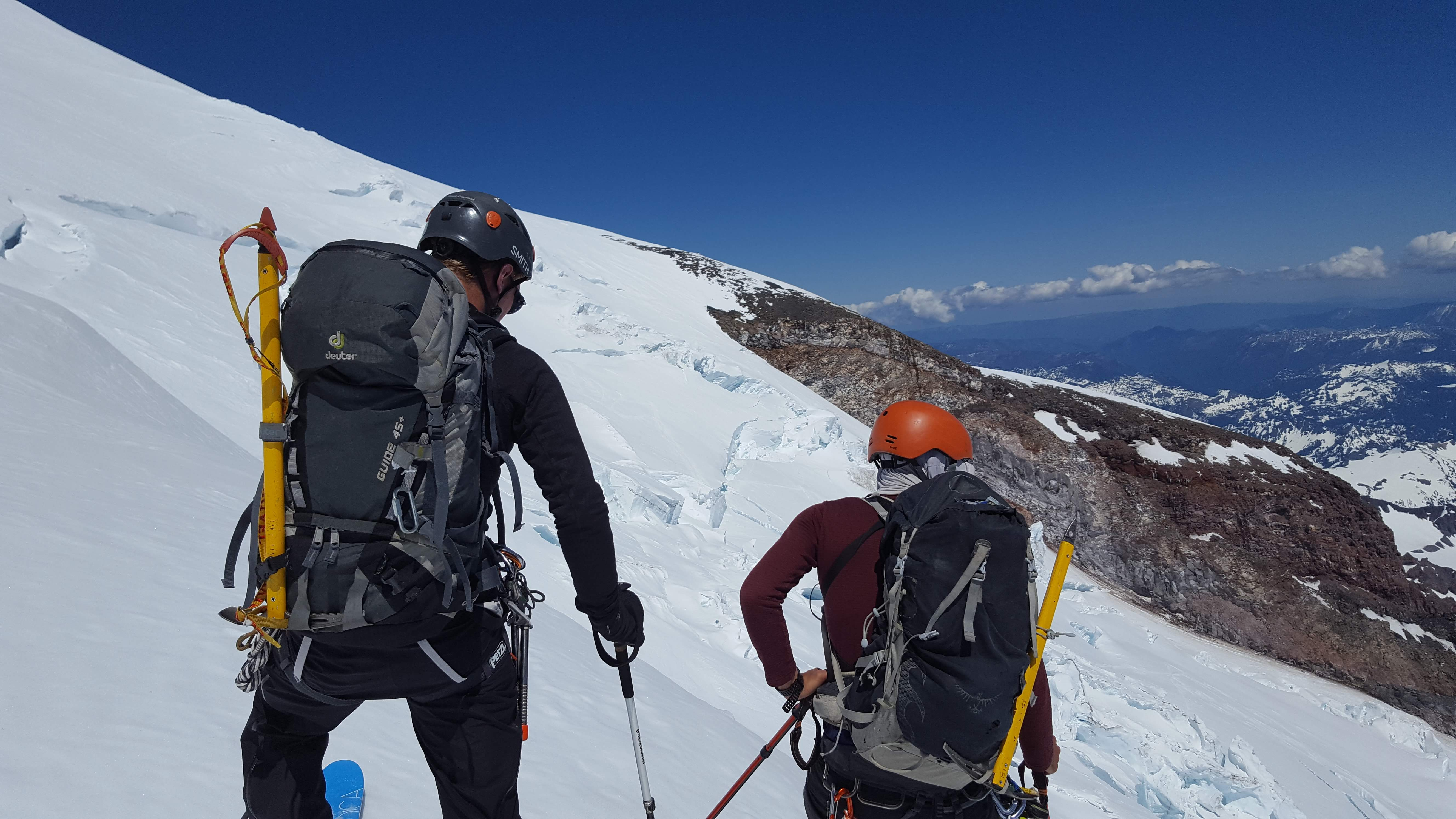 Justin and Tobias taking a look along the ridge as we evaluate our descent options. Photo cred: Duncan Pawson