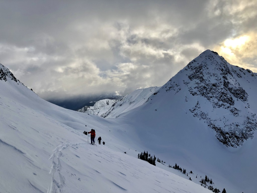 Skinning back up the wind scoured alpine. Peak 2222 on the right.
