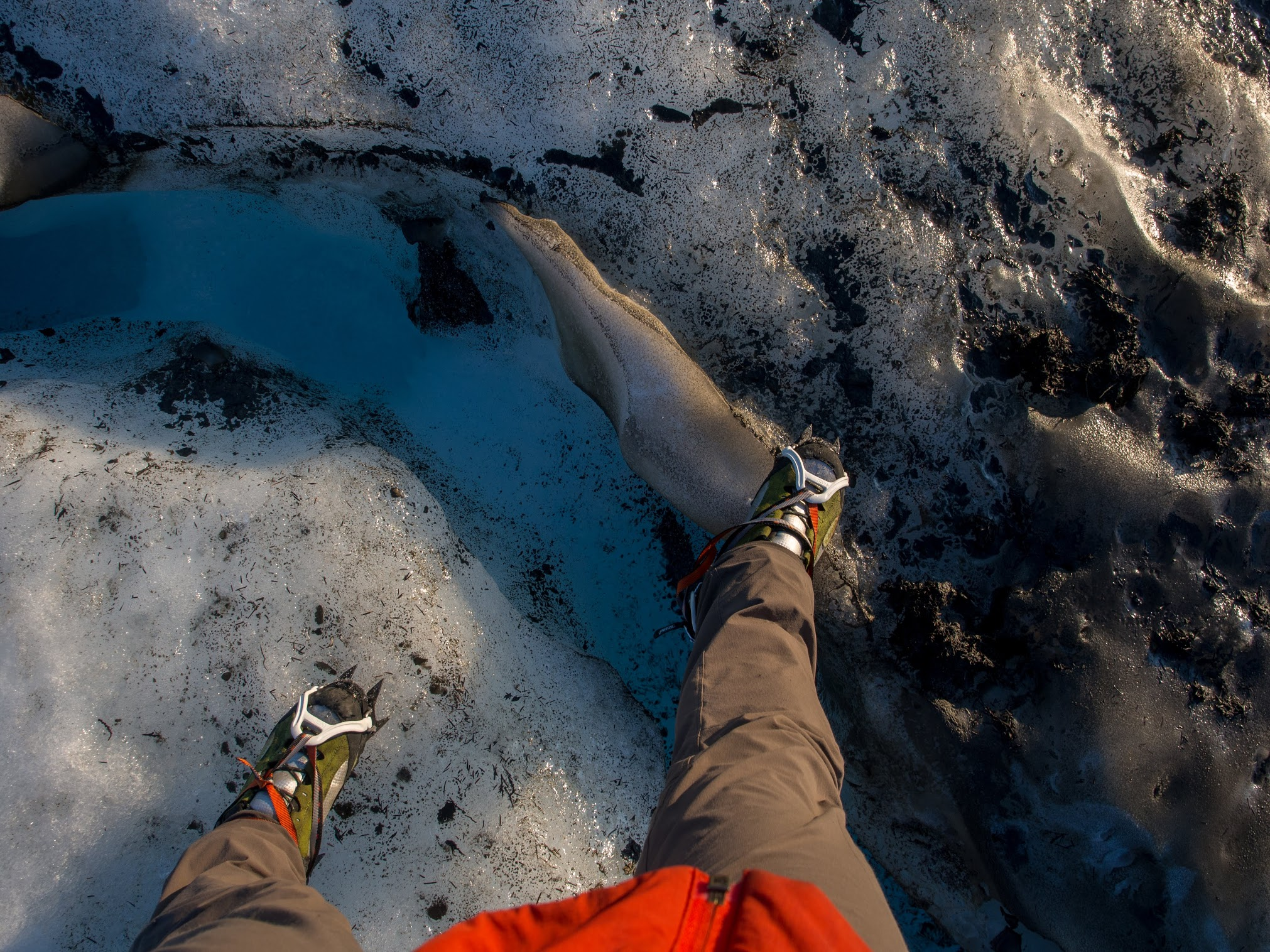 Ryan stepping over a very scary crevasse on Outrigger