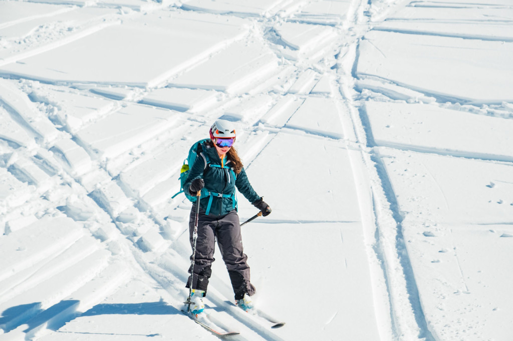 Haley Foladare skiing down with her super cool skiing/climbing dual-purpose helmet. (Photo by Vin Sanity)