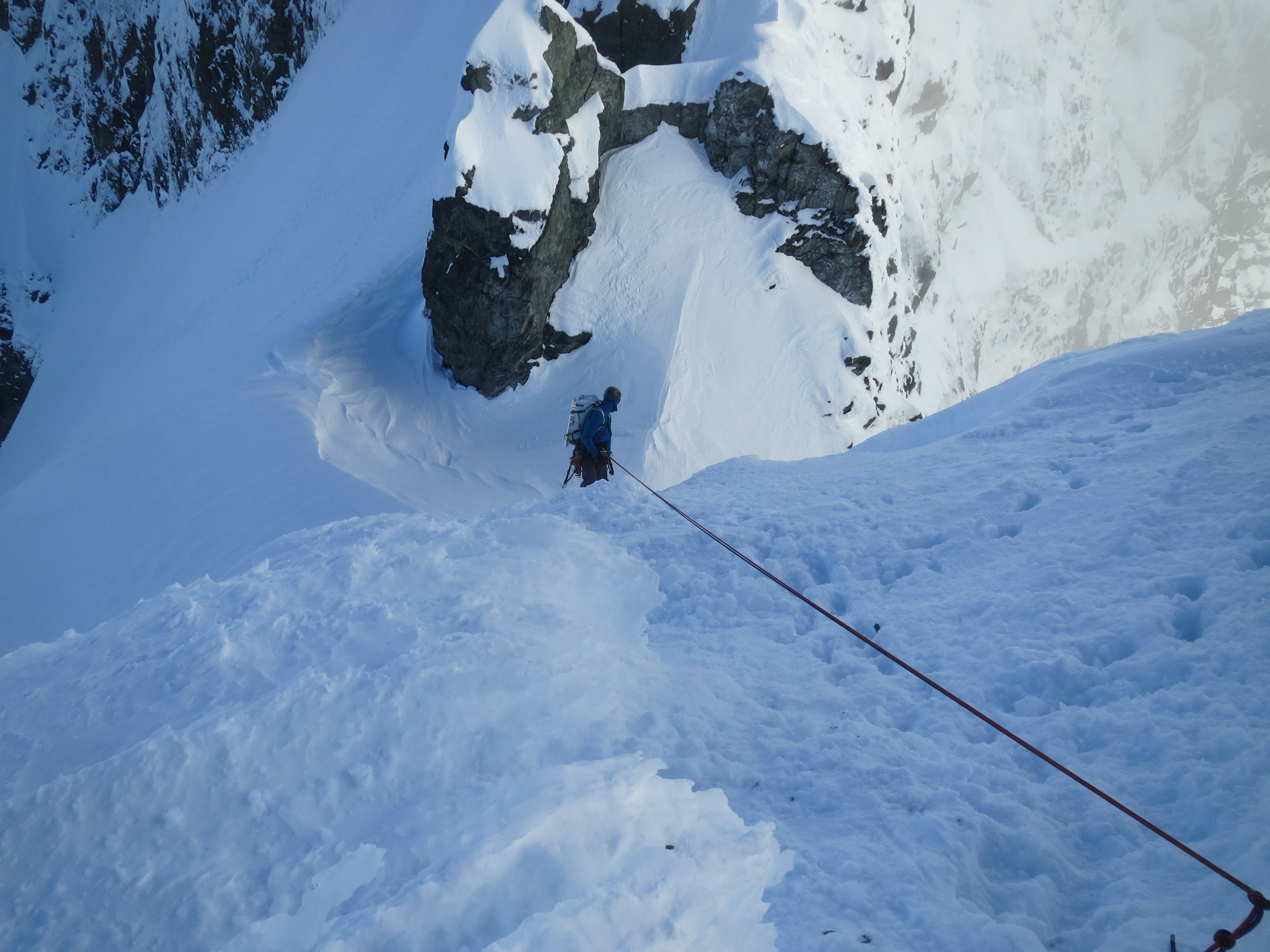 Liam rapping into the col at the top of our descent gully