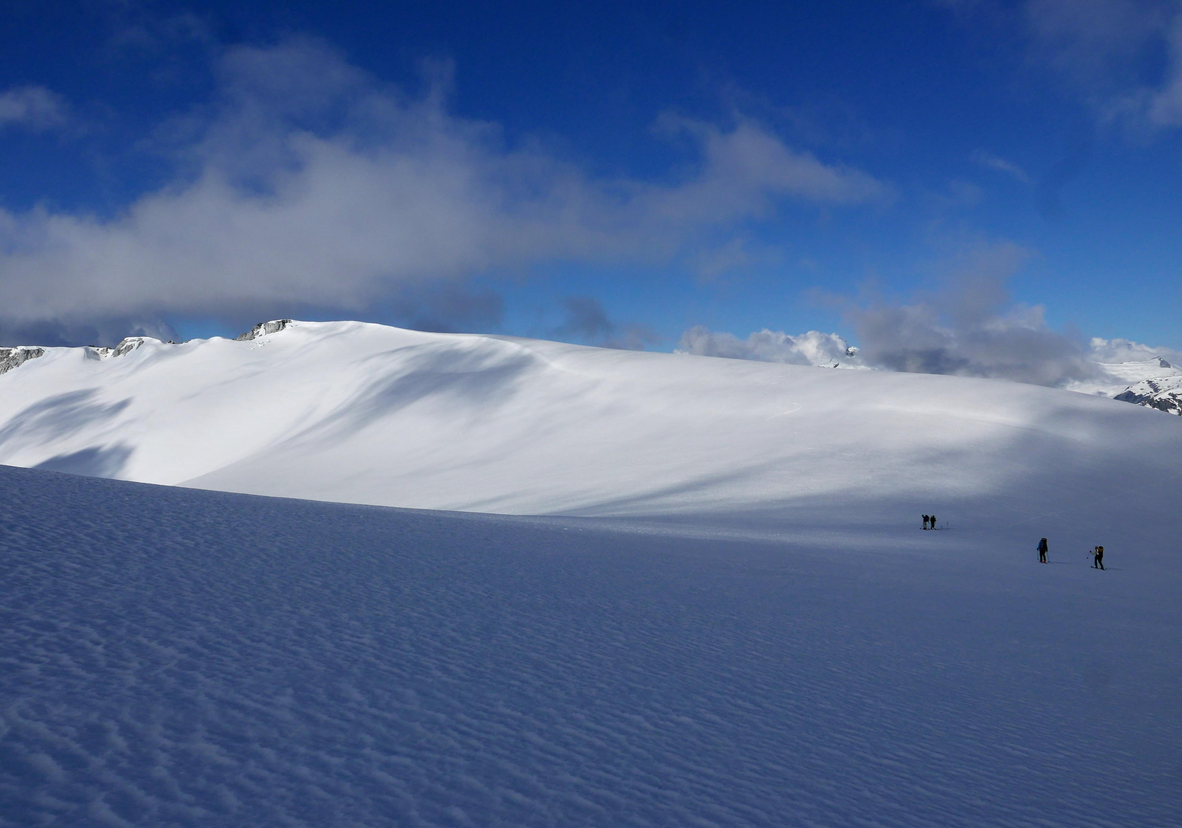 Skiing back onto the big glaciated col