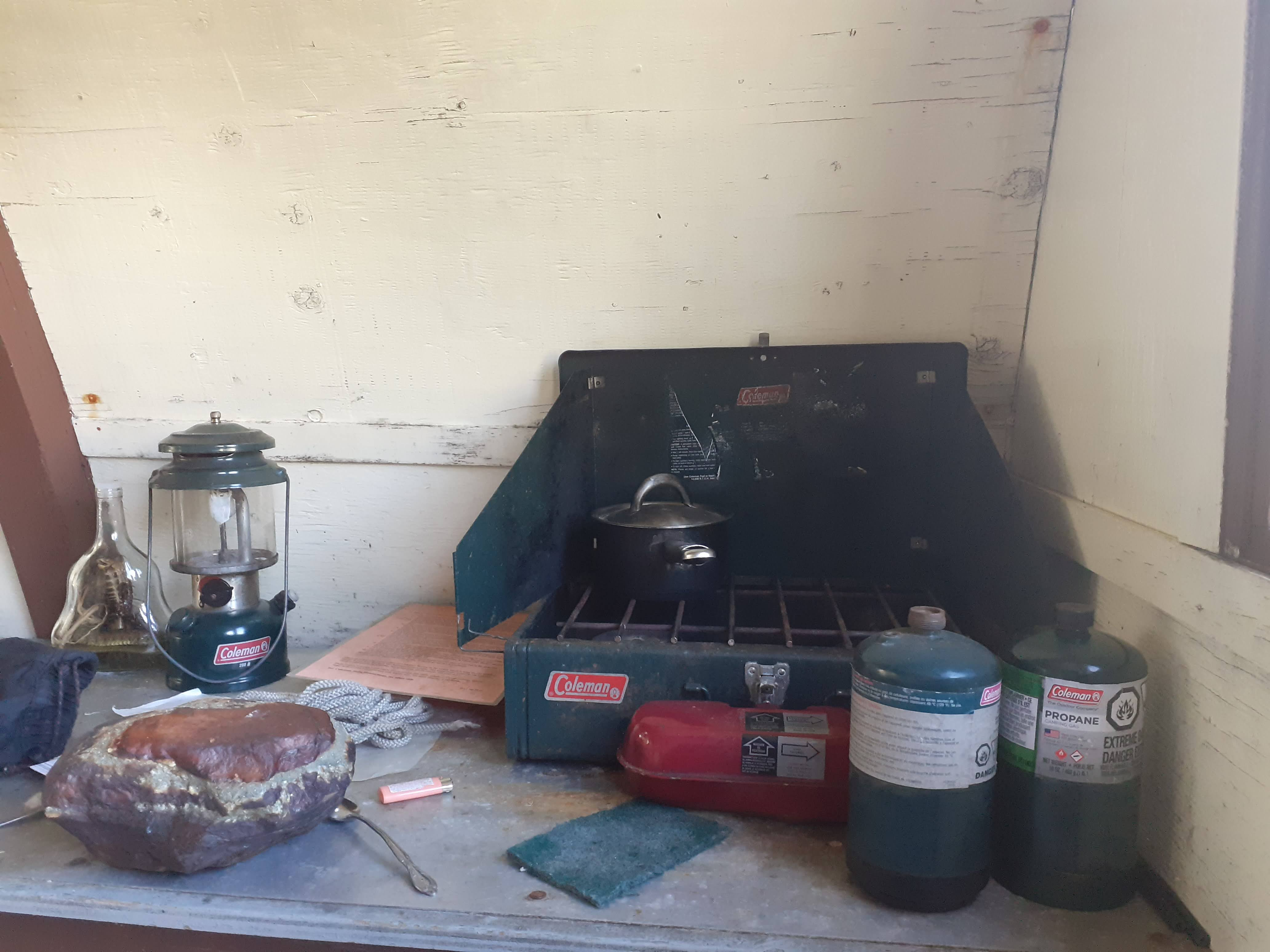 Cooking equipment and the forbidden Cobra drink (far left). Photo by Tom
