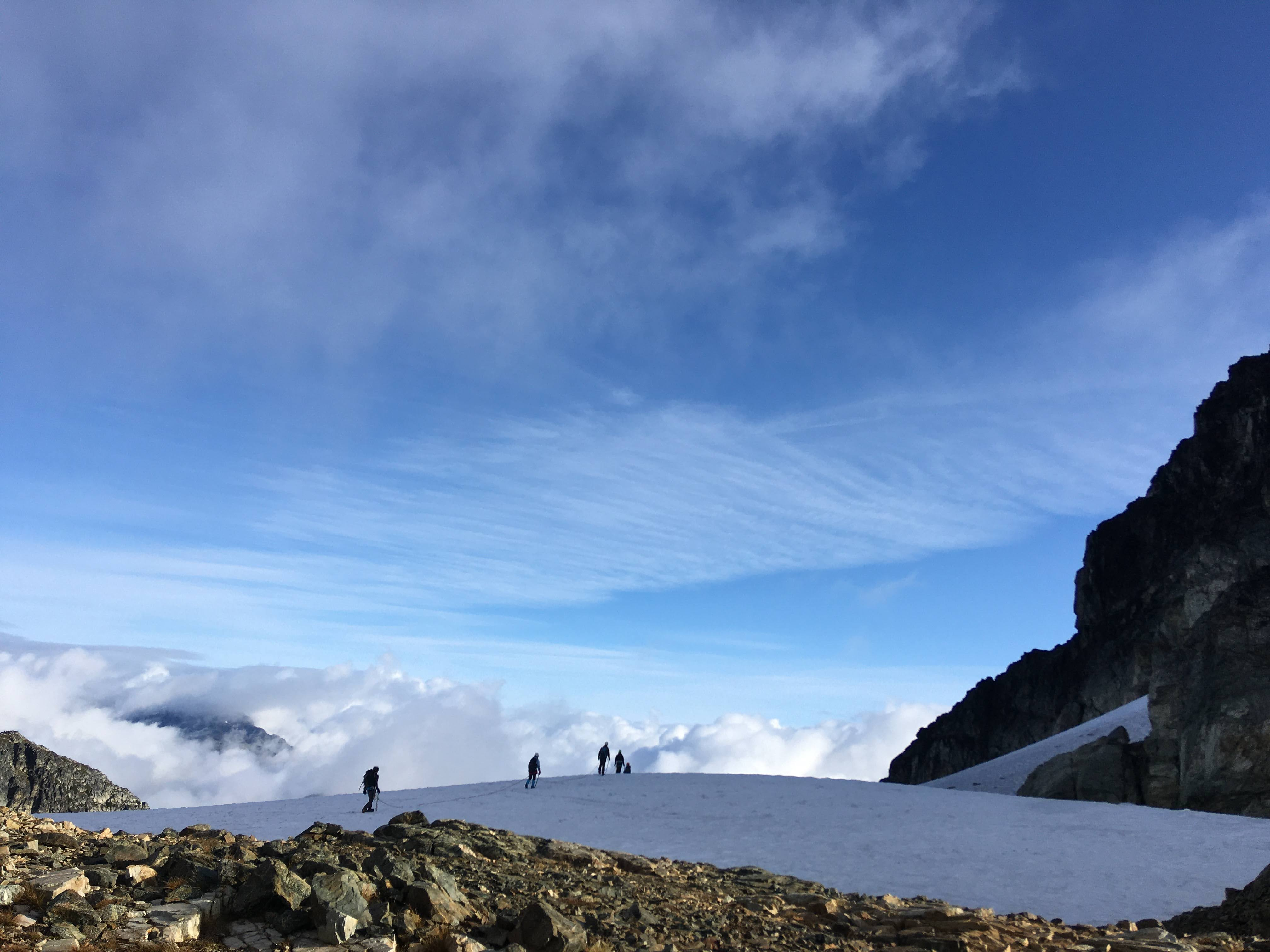 Kai's group walking into the clouds on the NE glacier. Photo by Melissa Bernstein