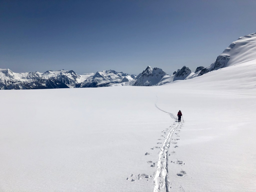 Julien plodding up the Mamquam Icefield with part of the Misty Icefield Traverse in the background.